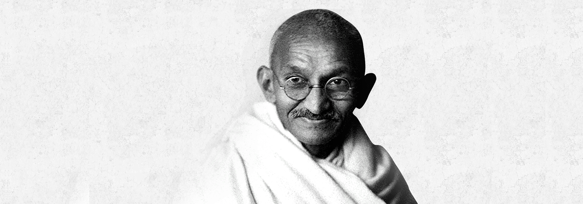Gandhi at age 62 in England