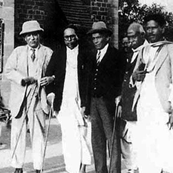 Signs the Poona Pact with Ambedkar